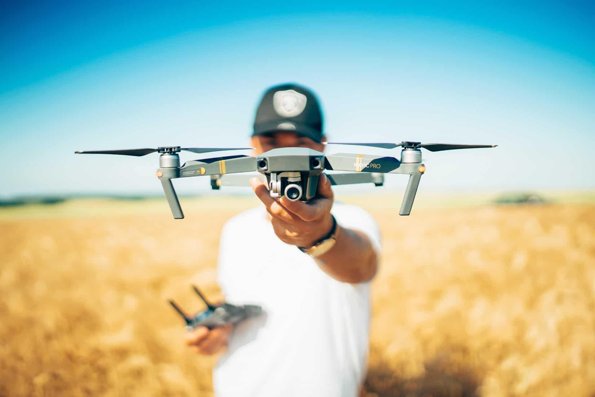 man holding a mavic drone